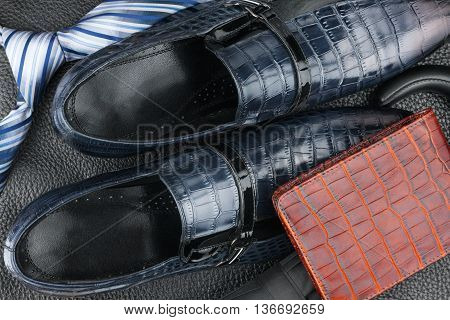 Classic mens blue shoes tie umbrella purse on natural leather can be used as background
