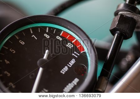 Close up shot of a motorcycle tachometer.