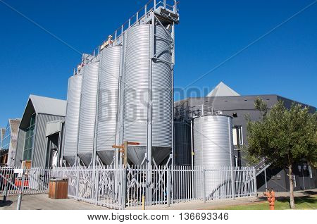 FREMANTLE,WA,AUSTRALIA-JUNE 1,2016: Little Creatures Brewery outdoor large conical fermentation vats in Fremantle, Western Australia.