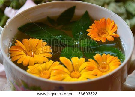 calendula and pepper mint herbs in a bowl