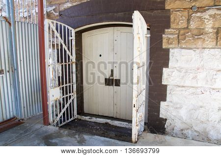 FREMANTLE,WA,AUSTRALIA-JUNE 13,2016: Old doors with security gate at the Fremantle Prison in Fremantle, Western Australia.