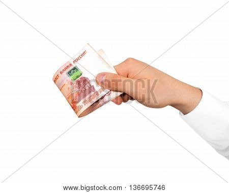 Hand holding stack of russian roubles isolated. Russia money five thousand banknote hold in hands. Bundle of red currency cash arm holder.