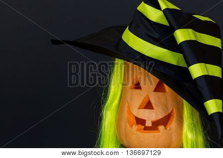 Scary Halloween pumpkins in hat isolated on a black background. Scary glowing faces. Halloween ideas . With your place for the text. Halloween costumes