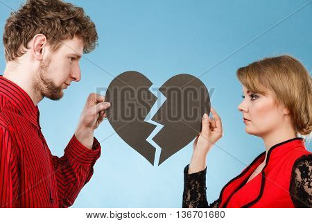 Couple With Broken Heart Breaking Up.