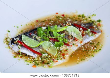 Steamed snapper fish with chili and lemon spicy cuisine.