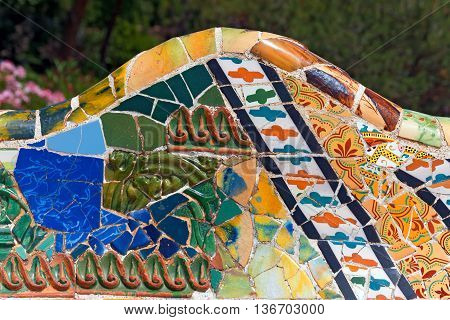 BARCELONA SPAIN - JUNE 10 2014: Detail of ceramic bench in the Park Guell designed by the famous architect Antoni Gaudi (1852-1926). UNESCO World Heritage Site