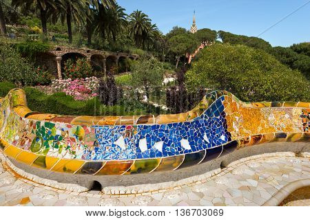BARCELONA SPAIN - JUNE 10 2014: Ceramic bench in the Park Guell designed by the famous architect Antoni Gaudi (1852-1926). UNESCO World Heritage Site