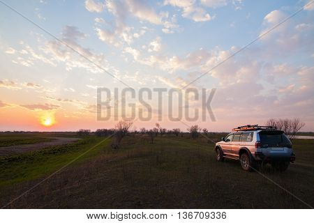 PRIAMURSKY RUSSIA - MAY 08 2016: 4x4 SUV on country road at sunset