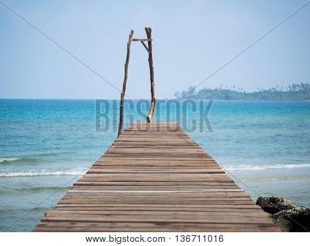 Old wooden Bridge to the blue sea at Koh Kood Trat Thailand