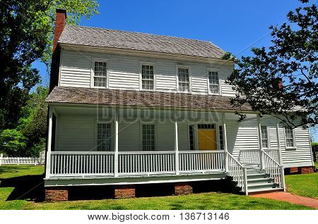Bath North Carolina - April 25 2016: Circa 1820 wooden frame Bonner House with portico nnd ell addition *
