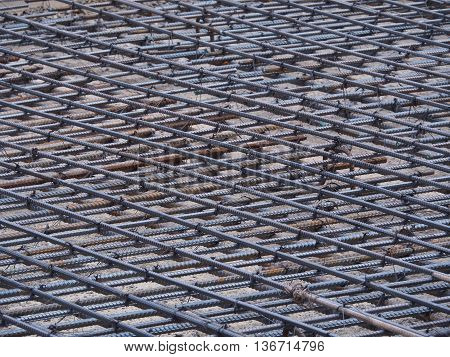 Iron mesh on the ground, prepare for pour cement. Iron mesh to strengthen a construction when cement is poured.