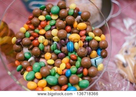 Chocolate And Rainbow Colorful Candy  In A Bowl