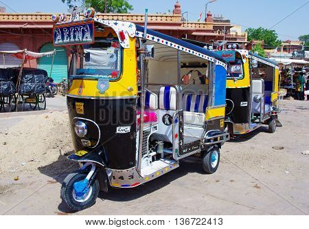 JODHPUR INDIA - SEPT 20: Auto rickshaw taxi on sept 20 2013 in Jodhpur India. These taxis are popular type of transport among locals and tourists.