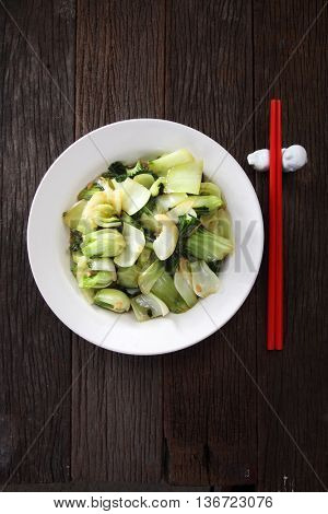 stir fried pak choy on the wooden background