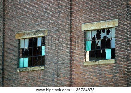 Broken windows on the walls of the old Joliet Steel Works in Joliet, Illinois.