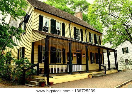 Old Salem North Carolina - April 21 2016: Old Salem Tavern still serves colonial restaurant food with wait staff dressed in 18th century Moravian clothing