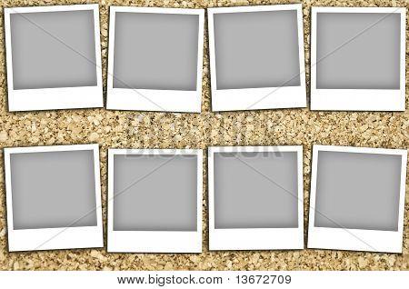 Empty Photos On A Corkboard