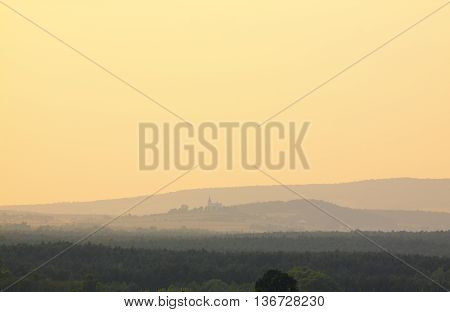 Misty sunset in Holy Cross Mountains, Poland