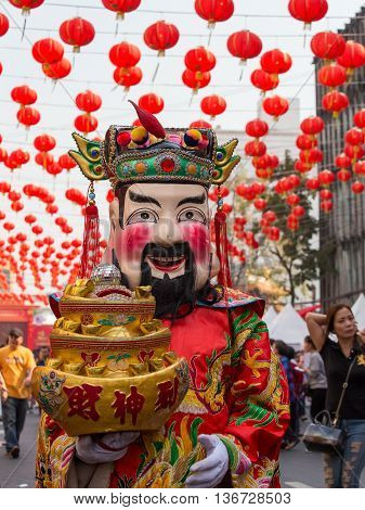 BANGKOK THAILAND - FEBRUARY 09 2016 : Thai man in traditional masks and costumes the street of Yaowarat in Chinatown during the celebration of Chinese New Year and Valentine's Day.