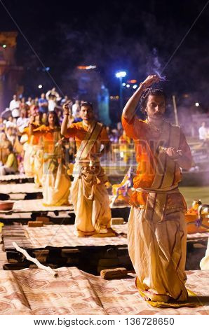 A Hindu Priest Performs The Ganga Aarti Religious  Ritual