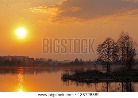 Warm sunset over lake. Poland, Holy Cross Mountains.