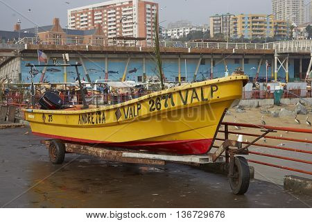 VALPARAISO, CHILE - JULY 1, 2016: Fishing boat on the dockside of the fishing harbour in Valparaiso, Chile.