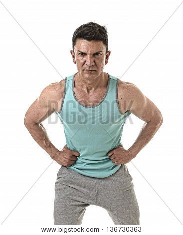 40s attractive hispanic sport man and bodybuilder in attitude corporate pose with strong shoulders wearing singlet having very fit and muscular body in mature bodybuilding and body care isolated