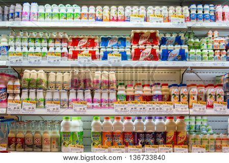 BANGKOK THAILAND - NOVEMBER 18 2013 : Selection of yogurts soy milk and milk on the shelves in a supermarket Siam Paragon in Bangkok Thailand.