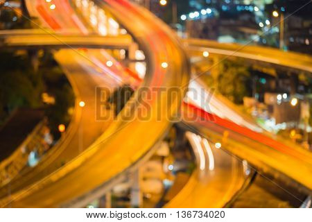 Blurred lights highway road intersection night view, close up abstract background
