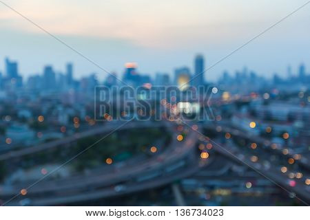 Aerial view highway interchange blurred lights with city downtown background