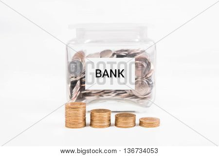 piggy bank pile gold coin with word text BANK on paper in glass piggy bank.(business bank and finance concept)