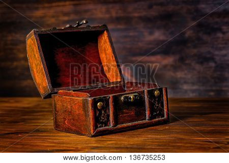 beautiful vintage treasure of mystery chest on wooden background with place for text close up