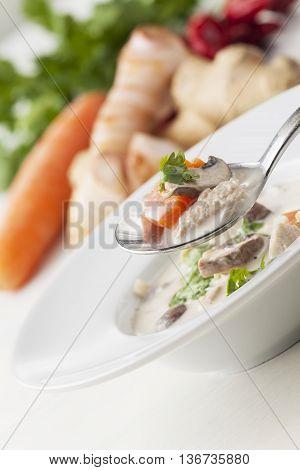 closeup of a thai tom kha gai soup