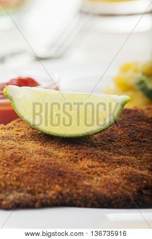closeup of a lemon on a schnitzel