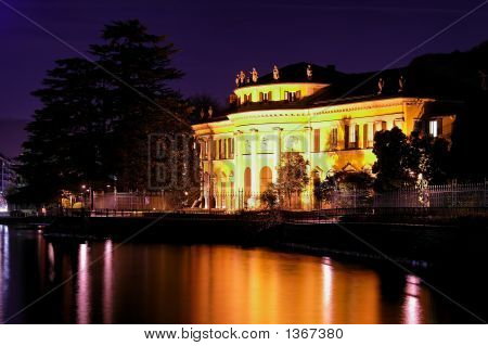 Lakeside Mansion At Night
