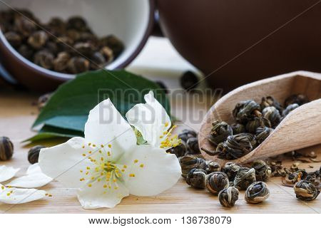 Green Tea With Jasmine On A Summer Background. Shallow Depth Of Field