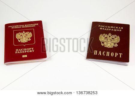 Russian passport and international passport on a white background