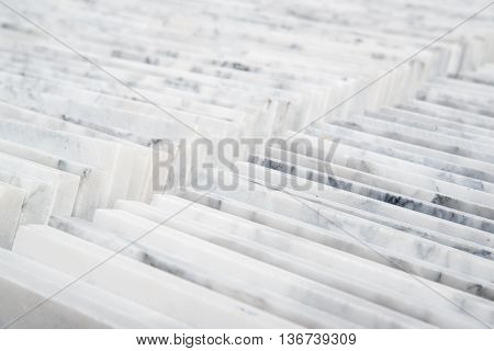 Stacks of high-quality Carrara marble tiles. Home and construction industry concept.