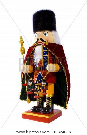 Wooden nutcracker with three small nutcracker figures