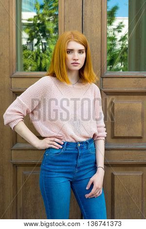 Red-haired Girl Near Wooden Doors