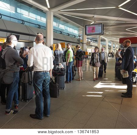 People Queue At Tegel Airport Check-in