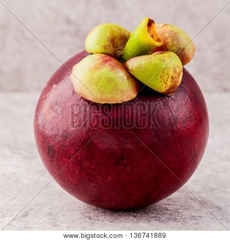 Delicious Mangosteen Fruit Arranged On Stone Background.mangosteen The Queen Of Thai Fruits.