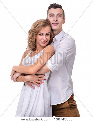 Happy young couple. Portrait of cheerful couple smiling against isolated white background