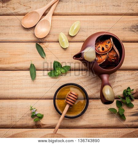 Herbal Tea Pot With Fresh Herbs Sage ,peppermint ,dried Indian Bael, Honey And Lime Slice On Rustic