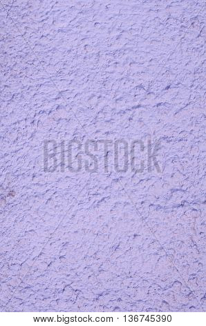 Background of a pale pink stucco coated and painted exterior rough cast of cement and concrete wall texture decorative coating