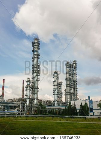 Distillation columns at a petrochemical plant. Deep processing of oil.