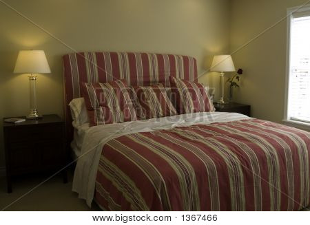 Nice bedroom with red bedding and a