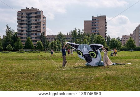 Saint-Petersburg Russia - June 26 2016: Kite Festival in the town of Pushkin. Users launch the kite as a lemur.