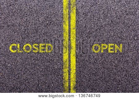 Tarmac With The Words Closed And Open