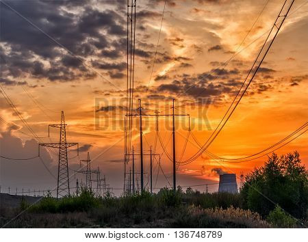 Power line of a nuclear power station sunset.